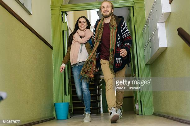 Happy Backpackers leaving Apartment