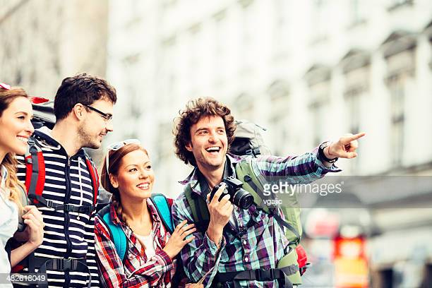 Happy Backpackers photographing in the city.