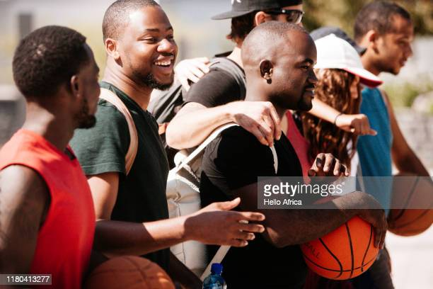 Happy basketball girlfriends with arms around each other
