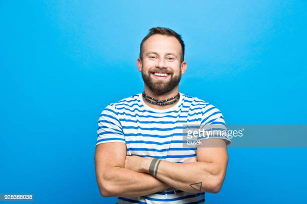 Happy bearded man in striped t-shirt, sailor style