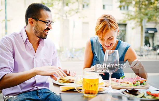 Happy Beautiful couple having lunch in outdoors cafe
