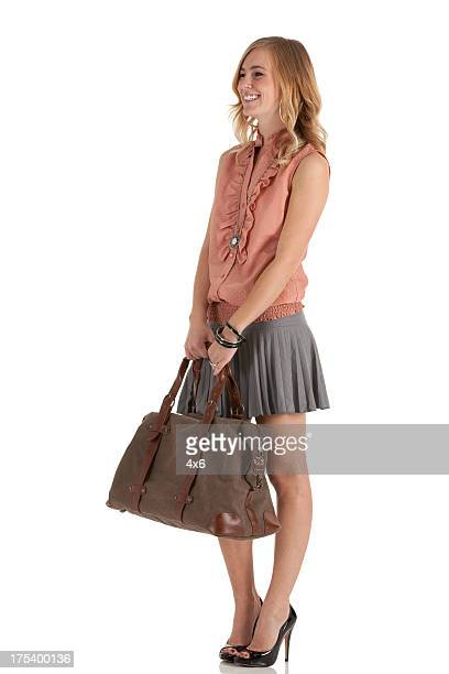 Happy beautiful woman carrying a hand bag
