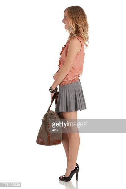 happy beautiful woman carrying hand bag - high heels short skirts stock pictures, royalty-free photos & images