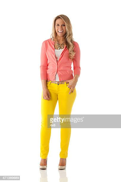 happy beautiful woman posing - yellow trousers stock pictures, royalty-free photos & images