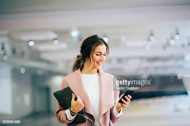 Happy beautiful woman texting
