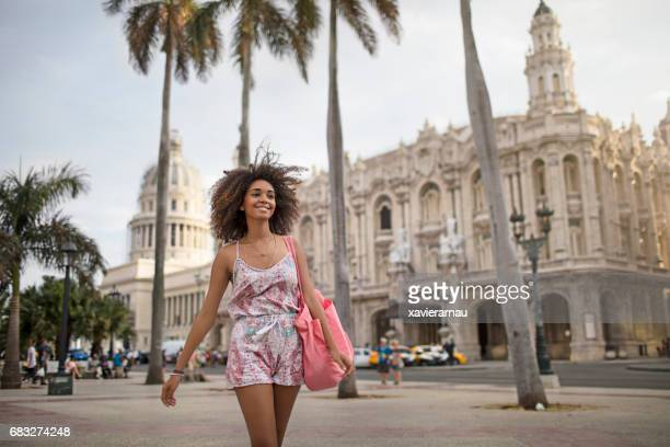 Happy beautiful woman walking in city