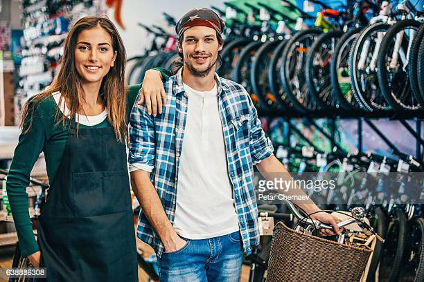 Happy bike shop owners