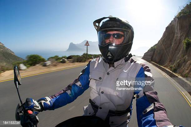 happy biker on the road - helmet visor stock pictures, royalty-free photos & images