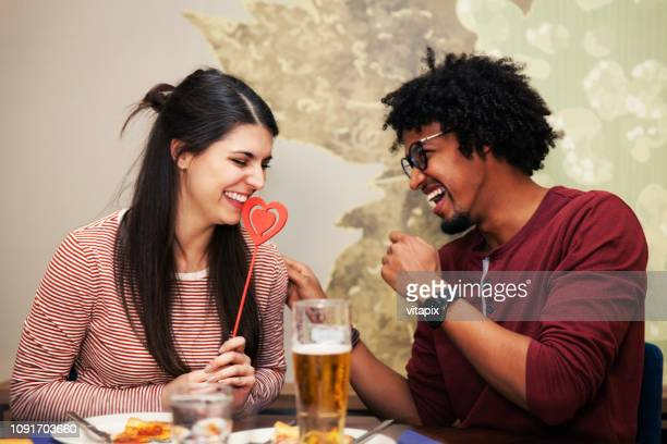 happy biracial couple on a date - valentines day couple stock pictures, royalty-free photos & images