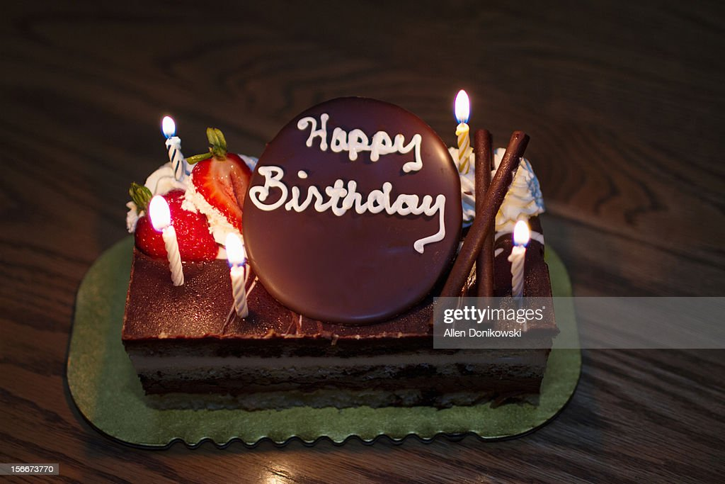 Cool Happy Birthday Cake With Candles High Res Stock Photo Getty Images Funny Birthday Cards Online Elaedamsfinfo