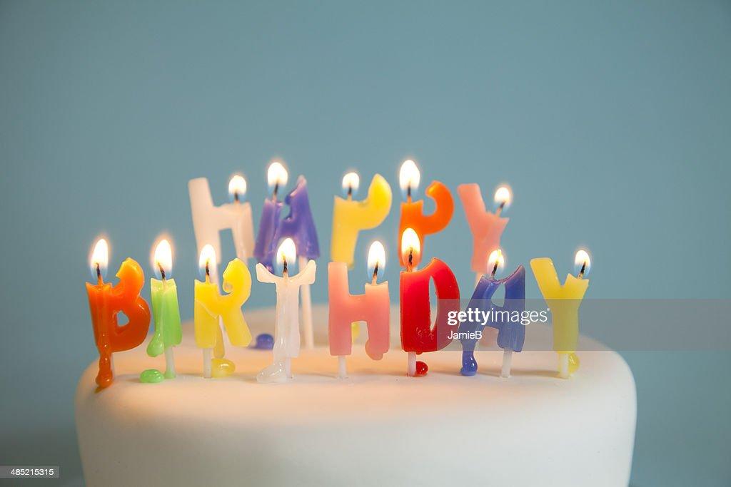 Happy Birthday candles on a birthday cake : Stock Photo