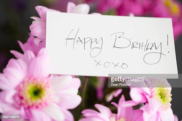 happy birthday card on bouquet - birthday card stock pictures, royalty-free photos & images