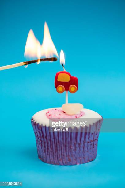 happy birthday cupcake. burning birthday candles for kids - birthday cake lots of candles stock photos and pictures