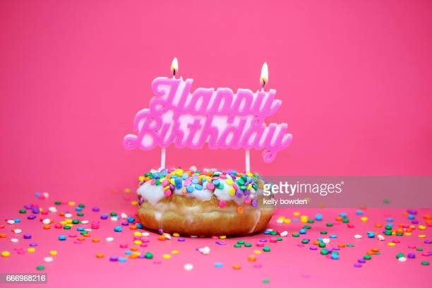 happy birthday doughnut cake - happy birthday stock pictures, royalty-free photos & images