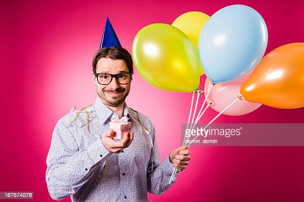 Happy birthday Geek man with pink gift and multicolored balloons