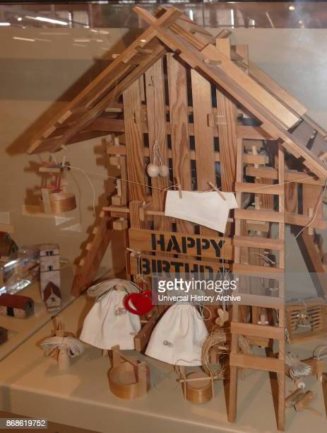 Happy Birthday House, 1979. Dolls house by British artist, Jane Blyth. It contains a musical box in the attic that plays Happy Birthday to You.