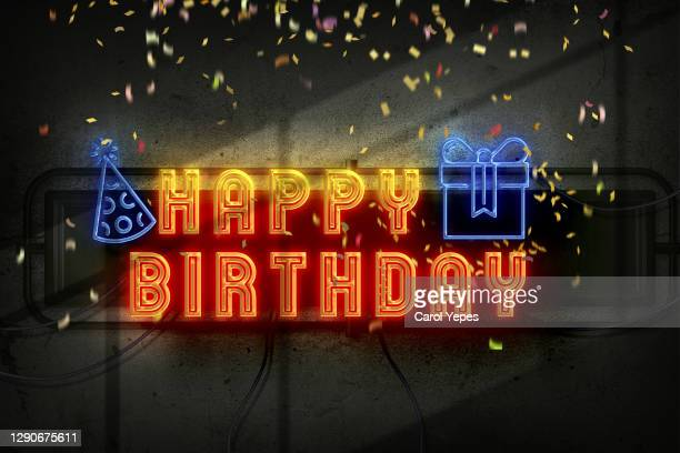 happy birthday in neon lights - birthday stock pictures, royalty-free photos & images