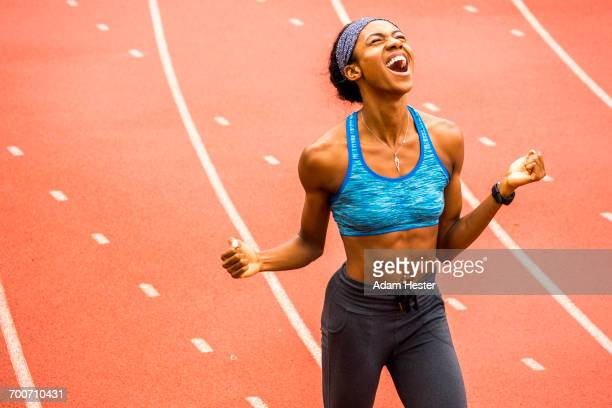 happy black athlete celebrating on track - olympian stock photos and pictures