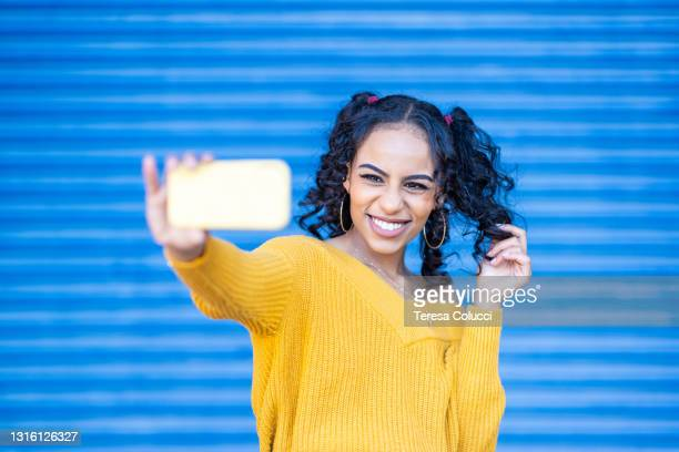 happy black woman taking a selfie and having fun - birmingham england stock pictures, royalty-free photos & images