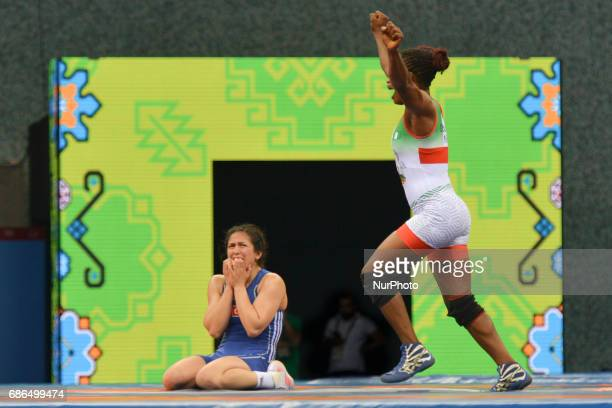 Happy Blessing Oborududu of Nigeria celebrates in front of disappointed Hafize Sahin of Turkey at the end of the Women's Freestyle 63kg Wrestling...