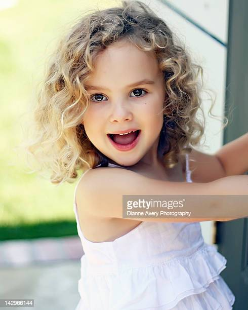 Happy blond curly haired young girl