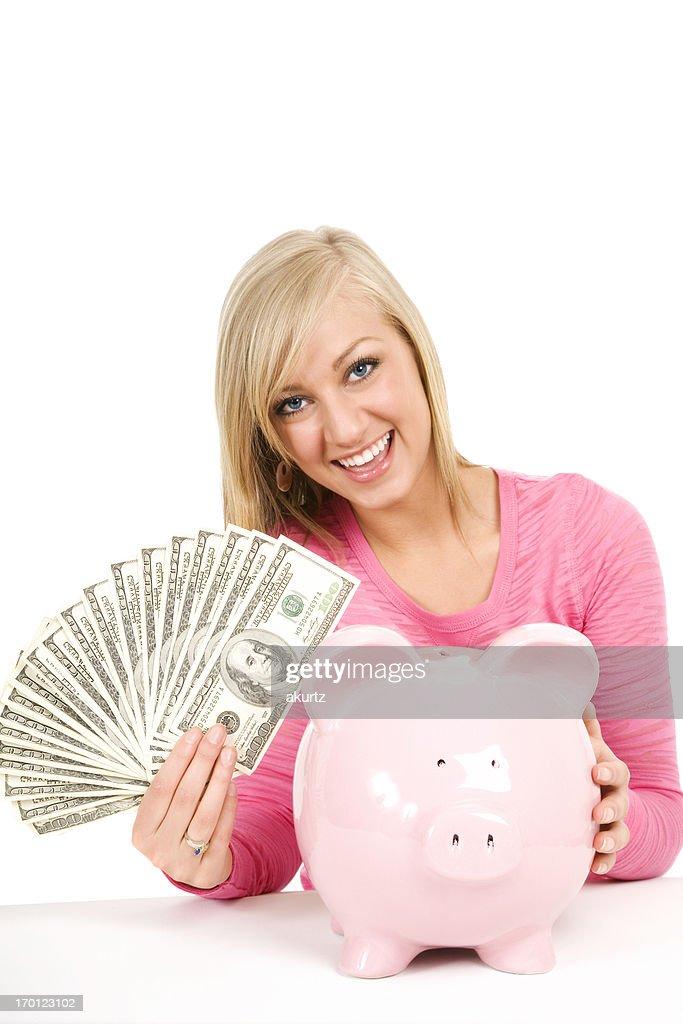 Happy blond woman holding money cash piggybank saving future isolated : Stock Photo