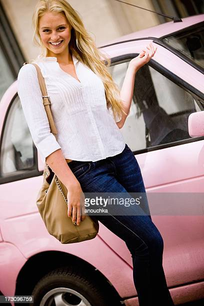Happy Blond Woman with her little pink car in London