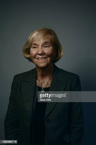 Happy blonde senior business woman in grey blazer jacket