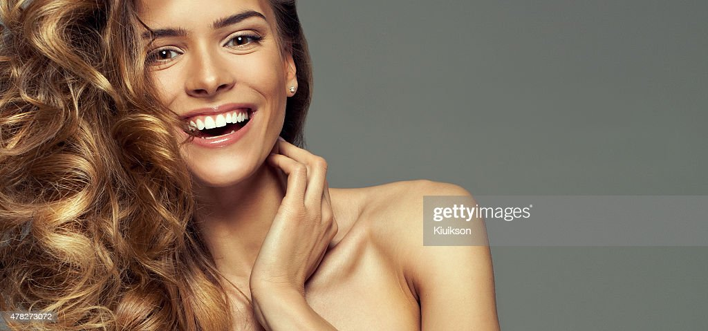 Happy blonde woman with copy space for your text : Stock Photo