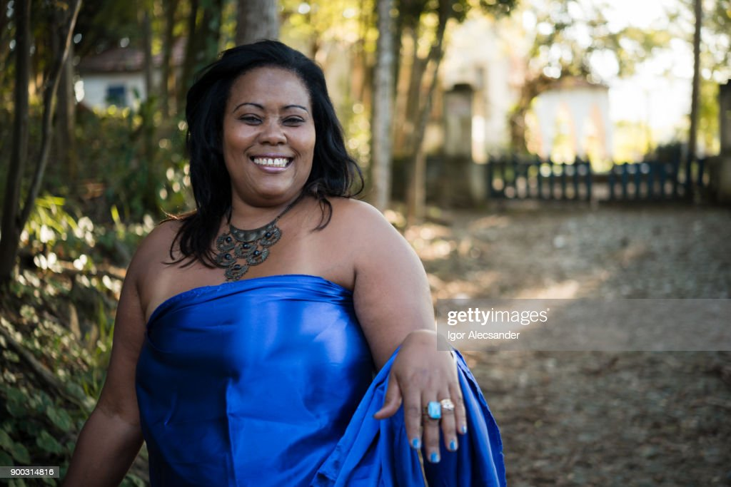 Happy body positive woman wearing blue clothes : Stock Photo