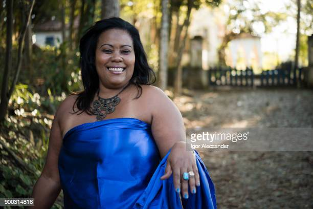 happy body positive woman wearing blue clothes - big beautiful black women stock photos and pictures