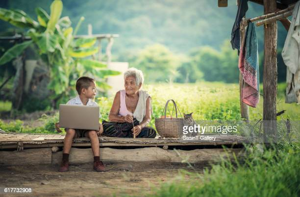 happy boy and grandmother - indonesia stock photos and pictures