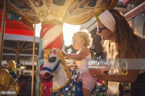 Happy Boy and Mother on Carousel