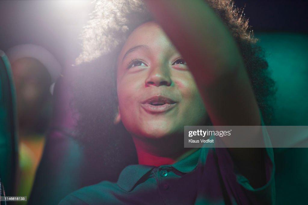 Happy boy at movie theater : Stock Photo