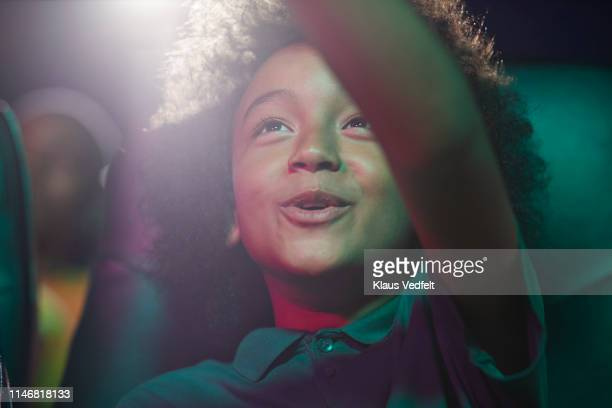 happy boy at movie theater - film industry stock pictures, royalty-free photos & images