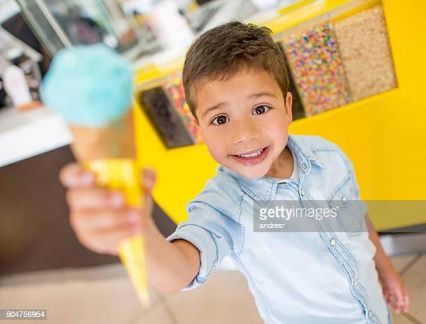 Happy boy eating an ice cream