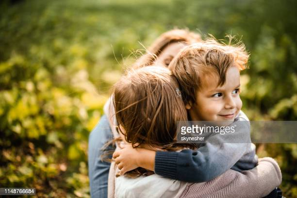 happy boy embracing his sister in the park. - in the park day 3 imagens e fotografias de stock