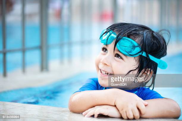 happy boy enjoying summer time in swimming pool - swimming stock pictures, royalty-free photos & images