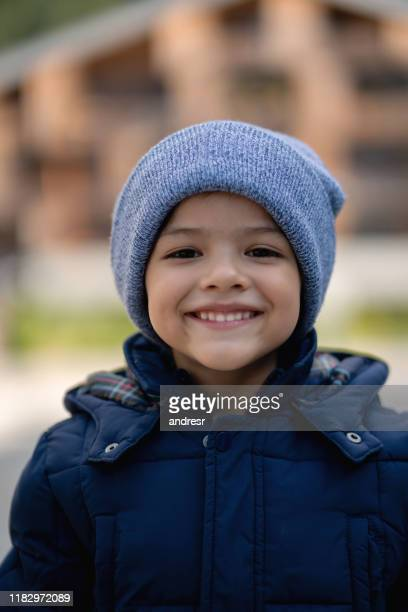 happy boy enjoying the winter outdoors - warm clothing stock pictures, royalty-free photos & images