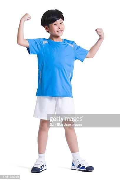 Happy boy flexing his bicep