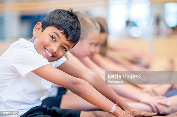 Happy Boy in an Exercise Class