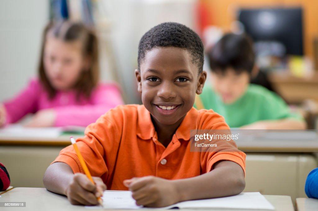 Happy Boy In Class : Stock Photo
