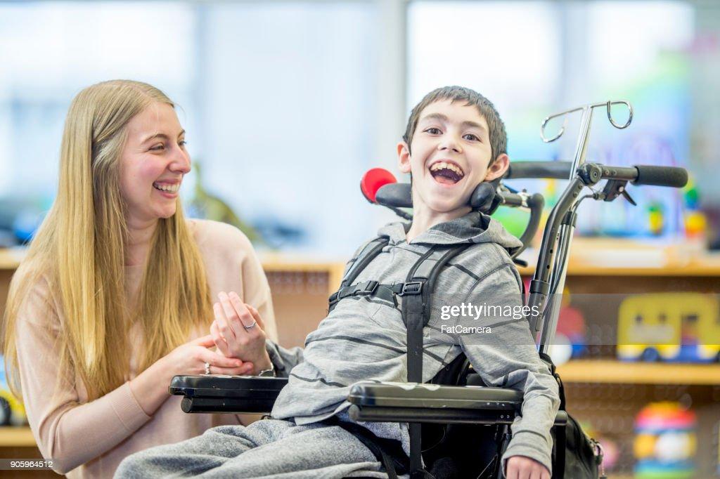 Happy Boy In Wheelchair : Stock Photo