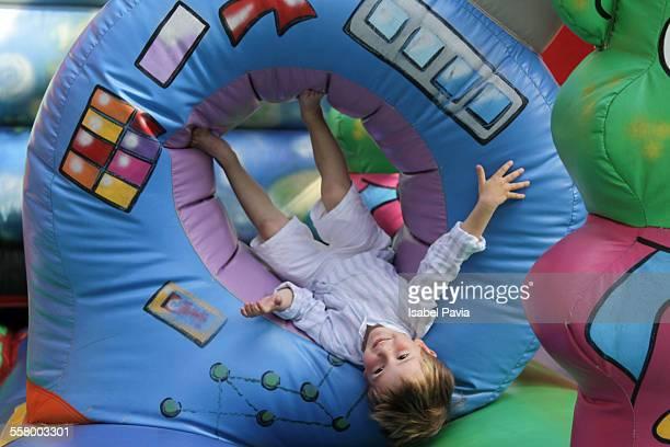 Happy boy on bounce house