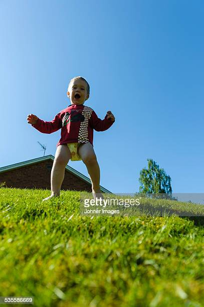 happy boy on grass - diaper teen stock photos and pictures
