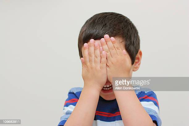 happy boy - hands covering eyes stock pictures, royalty-free photos & images
