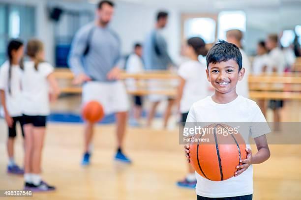 Happy Boy Playing Basketball