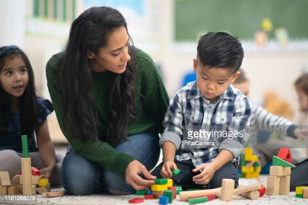 happy boy playing with blocks - montessori education stock pictures, royalty-free photos & images