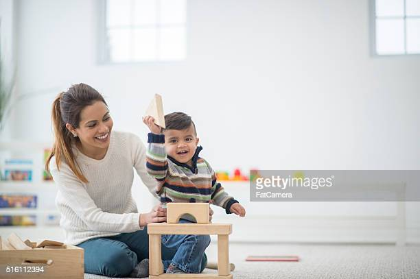 happy boy playing with blocks - indian baby stock photos and pictures