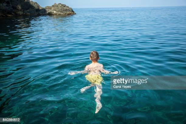 happy boy swimming in sea